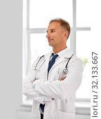 Купить «smiling doctor in white coat at hospital», фото № 32133667, снято 6 июля 2013 г. (c) Syda Productions / Фотобанк Лори