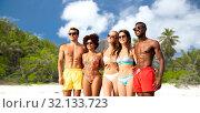 Купить «happy friends in swimwear hugging on summer beach», фото № 32133723, снято 29 июля 2018 г. (c) Syda Productions / Фотобанк Лори