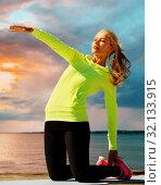 Купить «woman stretching on exercise mat over sea sunset», фото № 32133915, снято 19 июня 2013 г. (c) Syda Productions / Фотобанк Лори
