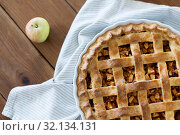 Купить «apple pie in baking mold on wooden table», фото № 32134131, снято 23 августа 2018 г. (c) Syda Productions / Фотобанк Лори