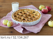 Купить «apple pie in baking mold on wooden table», фото № 32134267, снято 23 августа 2018 г. (c) Syda Productions / Фотобанк Лори