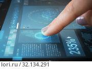 Купить «finger on touch screen with virtual data», фото № 32134291, снято 31 мая 2018 г. (c) Syda Productions / Фотобанк Лори