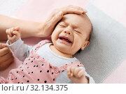 Купить «mother's hand touching crying little baby daughter», фото № 32134375, снято 23 мая 2019 г. (c) Syda Productions / Фотобанк Лори