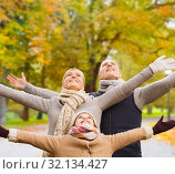 Купить «happy family having fun in autumn park», фото № 32134427, снято 12 октября 2014 г. (c) Syda Productions / Фотобанк Лори