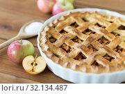 Купить «close up of apple pie on wooden table», фото № 32134487, снято 23 августа 2018 г. (c) Syda Productions / Фотобанк Лори