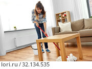 Купить «woman or housewife with mop cleaning floor at home», фото № 32134535, снято 13 апреля 2019 г. (c) Syda Productions / Фотобанк Лори