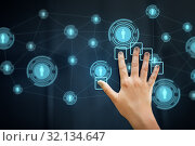 hand using interactive panel with network icons. Стоковое фото, фотограф Syda Productions / Фотобанк Лори