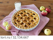 Купить «apple pie in baking mold on wooden table», фото № 32134667, снято 23 августа 2018 г. (c) Syda Productions / Фотобанк Лори