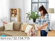 Купить «asian woman picking dirty laundry at home», фото № 32134715, снято 13 апреля 2019 г. (c) Syda Productions / Фотобанк Лори