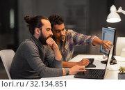 Купить «creative team with computer working late at office», фото № 32134851, снято 24 января 2018 г. (c) Syda Productions / Фотобанк Лори