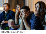 Купить «friends with beer and popcorn watching tv at home», фото № 32134891, снято 22 декабря 2018 г. (c) Syda Productions / Фотобанк Лори