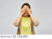 young woman with eyes closed by hands. Стоковое фото, фотограф Syda Productions / Фотобанк Лори