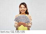 Купить «asian woman with hundreds of dollar money», фото № 32135135, снято 11 мая 2019 г. (c) Syda Productions / Фотобанк Лори