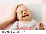 Купить «mother's hand touching crying little baby daughter», фото № 32135147, снято 23 мая 2019 г. (c) Syda Productions / Фотобанк Лори
