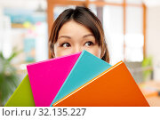 Купить «asian woman or student hiding behind notebooks», фото № 32135227, снято 11 мая 2019 г. (c) Syda Productions / Фотобанк Лори