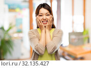 Купить «happy amazed asian woman over background», фото № 32135427, снято 11 мая 2019 г. (c) Syda Productions / Фотобанк Лори