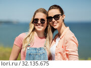 Купить «teenage girls or best friends at seaside in summer», фото № 32135675, снято 20 июня 2019 г. (c) Syda Productions / Фотобанк Лори