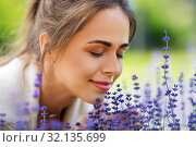 Купить «close up of woman smelling lavender flowers», фото № 32135699, снято 12 июля 2019 г. (c) Syda Productions / Фотобанк Лори