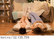 Купить «female friends lying on floor at home pajama party», фото № 32135759, снято 21 января 2018 г. (c) Syda Productions / Фотобанк Лори
