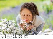 Купить «close up of woman smelling chamomile flowers», фото № 32135971, снято 12 июля 2019 г. (c) Syda Productions / Фотобанк Лори
