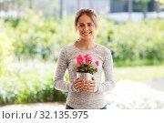 Купить «young woman with cyclamen flowers at summer garden», фото № 32135975, снято 12 июля 2019 г. (c) Syda Productions / Фотобанк Лори