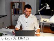 Купить «businessman with papers working at night office», фото № 32136135, снято 25 января 2019 г. (c) Syda Productions / Фотобанк Лори
