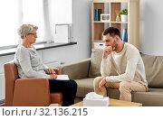 senior woman psychologist and sad man patient. Стоковое фото, фотограф Syda Productions / Фотобанк Лори