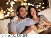 Купить «couple with popcorn watching tv at night at home», фото № 32136299, снято 27 января 2018 г. (c) Syda Productions / Фотобанк Лори