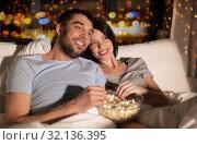 Купить «couple with popcorn watching tv at night at home», фото № 32136395, снято 27 января 2018 г. (c) Syda Productions / Фотобанк Лори