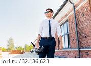 Купить «businessman with folding scooter on rooftop», фото № 32136623, снято 1 августа 2019 г. (c) Syda Productions / Фотобанк Лори