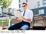 Купить «businessman with scooter reading newspaper in city», фото № 32136743, снято 1 августа 2019 г. (c) Syda Productions / Фотобанк Лори