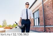 Купить «businessman with folding scooter on rooftop», фото № 32136963, снято 1 августа 2019 г. (c) Syda Productions / Фотобанк Лори