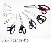 Купить «Top view of semicircle from various scissors on white background», фото № 32139415, снято 27 февраля 2020 г. (c) easy Fotostock / Фотобанк Лори
