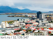 Travel to Iceland - above view of Midborg district and Atlantic Ocean in Reykjavik city from Hallgrimskirkja church in september. Стоковое фото, фотограф Zoonar.com/Valery Voennyy / easy Fotostock / Фотобанк Лори