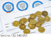 Tax notice, tax envelopes and ten ruble coins. Редакционное фото, фотограф Иванов Алексей / Фотобанк Лори