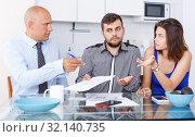 Купить «Unhappy young couple signing financial agreement with social worker», фото № 32140735, снято 6 июля 2018 г. (c) Яков Филимонов / Фотобанк Лори