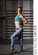 Купить «Woman practicing pole dancing in dark studio», фото № 32140959, снято 10 мая 2018 г. (c) Яков Филимонов / Фотобанк Лори