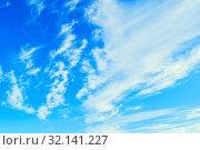 Купить «Небесный пейзаж. Синее небо. Blue sky background -colorful clouds lit by sunlight. Picturesque sky view in bright tones», фото № 32141227, снято 22 июня 2018 г. (c) Зезелина Марина / Фотобанк Лори