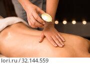 Купить «back massage with hot oil candle at spa», фото № 32144559, снято 26 января 2017 г. (c) Syda Productions / Фотобанк Лори