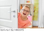 happy smiling beautiful girl behind door at home. Стоковое фото, фотограф Syda Productions / Фотобанк Лори
