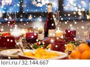 Купить «food and drinks on christmas table at home», фото № 32144667, снято 17 декабря 2017 г. (c) Syda Productions / Фотобанк Лори