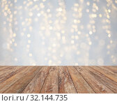 Купить «empty wooden table with christmas golden lights», фото № 32144735, снято 14 февраля 2014 г. (c) Syda Productions / Фотобанк Лори