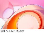Купить «The background photo is colored rounded plates in close-up.», фото № 32145259, снято 28 апреля 2019 г. (c) Olesya Tseytlin / Фотобанк Лори