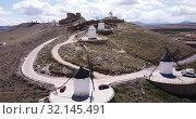 Купить «Picturesque rural landscape of Consuegra with famous windmills in sunny day, Spain», видеоролик № 32145491, снято 23 апреля 2019 г. (c) Яков Филимонов / Фотобанк Лори