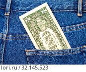 Купить «American dollar sticking out of the jeans pocket», фото № 32145523, снято 14 декабря 2015 г. (c) FotograFF / Фотобанк Лори