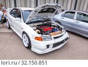 Купить «Tuned turbo car engine of Mitsubishi vehicle», фото № 32150851, снято 19 мая 2018 г. (c) FotograFF / Фотобанк Лори