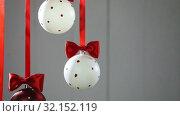 Купить «Christmas balls hanging with ribbons», видеоролик № 32152119, снято 7 сентября 2019 г. (c) Иван Михайлов / Фотобанк Лори