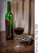 Bottle, glass of wine and corkscrew. Стоковое фото, фотограф Юрий Бизгаймер / Фотобанк Лори
