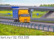 Купить «Truck goes on an automobile outcome», фото № 32153335, снято 14 июня 2016 г. (c) Юрий Бизгаймер / Фотобанк Лори