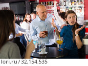Купить «Man trying to talk with angry woman», фото № 32154535, снято 25 марта 2019 г. (c) Яков Филимонов / Фотобанк Лори